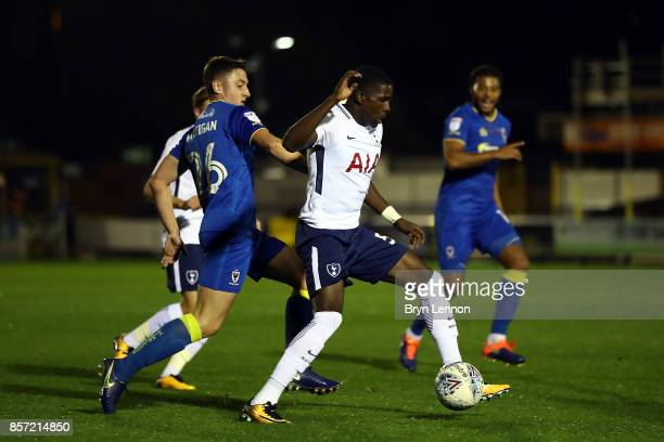 Shilow Tracey of Tottenham Hotspur avoids Anthony Hartigan of AFC Wimbledon during the Checkatrade Trophy match between AFC Wimbledon and Tottenham...