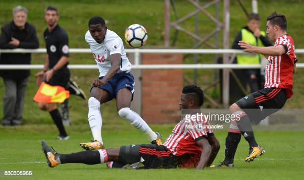 Shilow Tracey of Tottenham Hotspur has his cross blocked by Papy Djilobodji of Sunderland during the Premier League 2 match between Sunderland and...