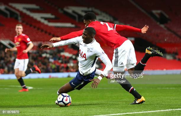 Shilow Tracey of Tottenham Hotspur looses his footing under pressure from Tyrell Warren of Manchester United during the Premier League 2 match...