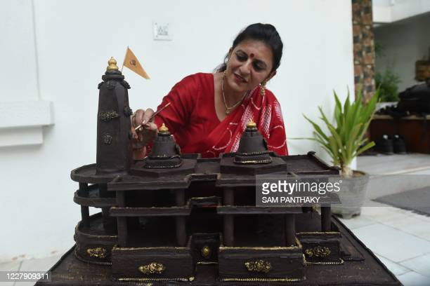Shilpa Bhatt an entrepreneur and manufacturersupplier of chocolates gives finishing touches to the model of Ram temple of Ayodhya on the outskirts of...