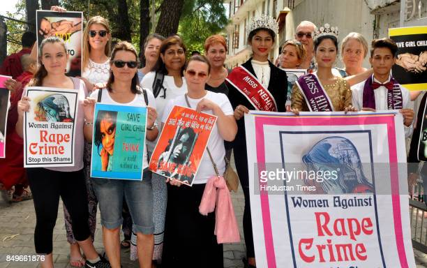 Shilpa Negi Miss Himalaya 2017 Neha Chaudhary Miss Glory of India 2017 and foreign tourists hold placard to show their support towards crime against...