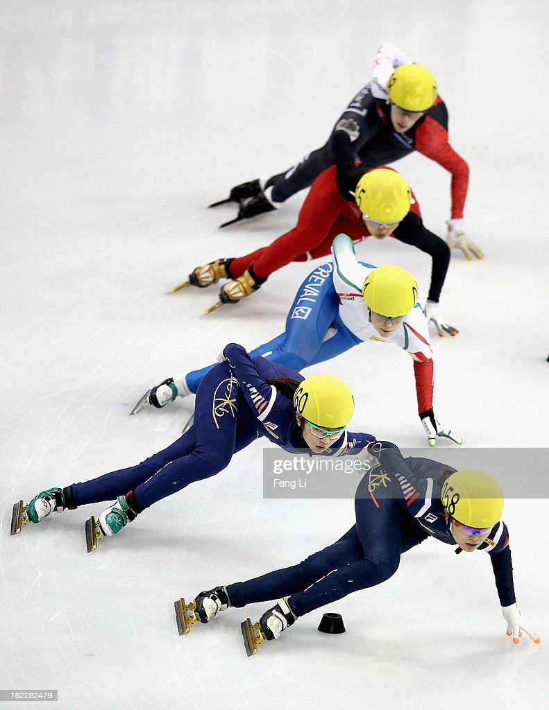 Shim Suk Hee and Kim Alang of Korea, Arianna Fontana of Italy, Li Jianrou of China and Marianne St-Gelais of Canada compete in the Women's 1000m Final during day four of the Samsung ISU World Cup Short Track at the Oriental Sports Center on September 29, 2013 in Shanghai, China.