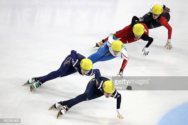 Shim Suk Hee and Kim Alang of Korea Arianna Fontana of Italy Li Jianrou of China and Marianne StGelais of Canada compete in the Women's 1000m Final...