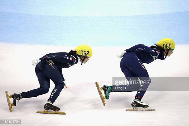 Shim Suk Hee and Kim Alang of Korea compete in the Women's 1500m Final during day three of the Samsung ISU World Cup Short Track at the Oriental...