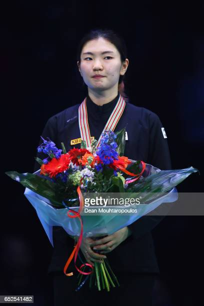 Shim Suk Hee of Korea with the bronze medal celebrates after the Ladies overall ceremony during day two of ISU World Short Track Championships at...