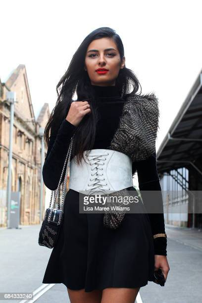 Shima Khosravi wearing a dress from Turkey teamed with shoes from Zara Sheik belt glasses and bag by Mango during MercedesBenz Fashion Week Resort 18...