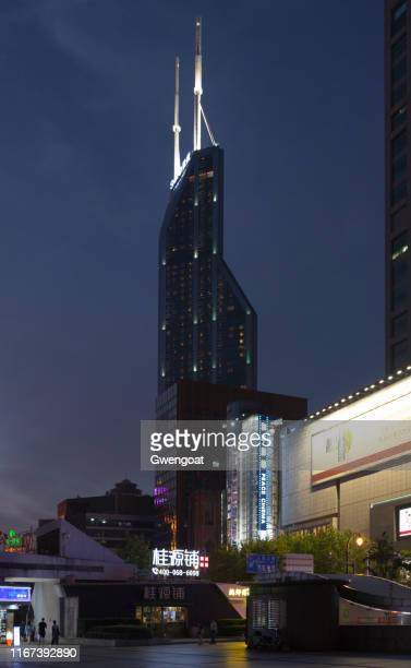 shimao international plaza in shanghai - gwengoat stock pictures, royalty-free photos & images