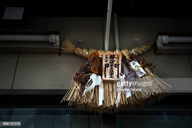 Shimenawa rice straw ropes hanging over door