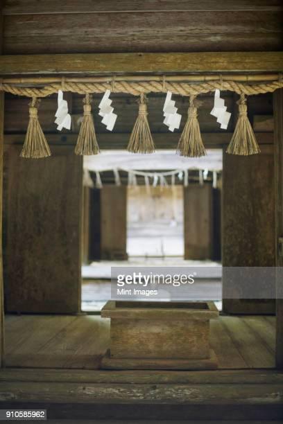 Shimenawa ropes decorating Shinto Sakurai Shrine, Fukuoka, Japan.