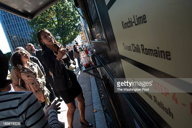 Shimika Wilder places and order for lunch from a food truck in Farragut Square in Washington, DC on October 18, 2013. Wilder said she used to be anti...