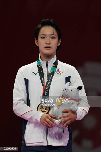 Shimizu Kiyou of Japan poses with her gold medal after the Women's Individual Karate Kata final at the JCC PLenary Hall on day seven of the Asian...