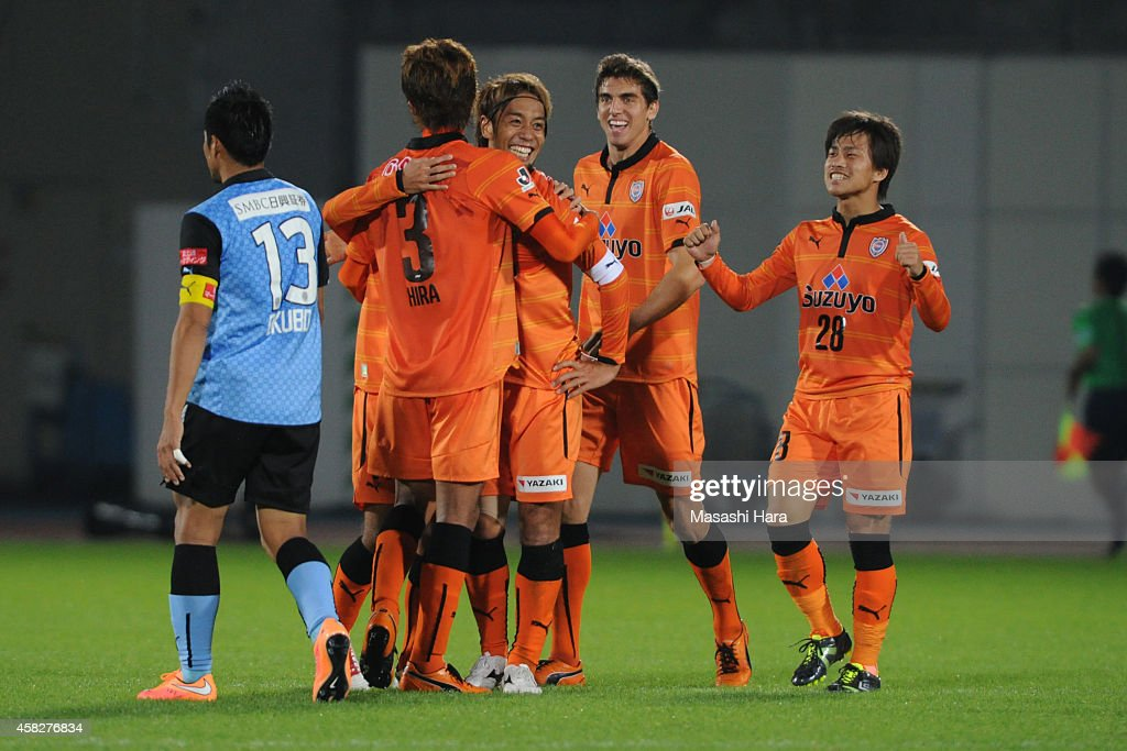 Shimizu S-Pulse players celebrate the third goal during the J.League match between Kawasaki Frontale and Shimzu S-Pulse at Todoroki Stadium on November 2, 2014 in Kawasaki, Kanagawa, Japan.