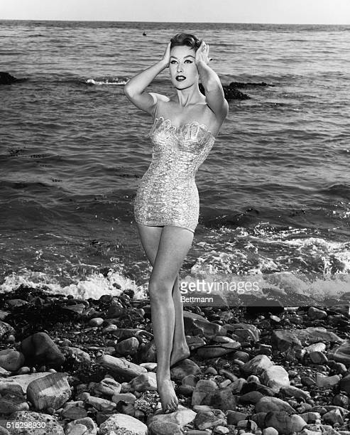 FASHION NEWS Shimmering like a silver mermaid any girl would be the hit of the beach in this unusual bathing suit Bodice flares out like the seashell...