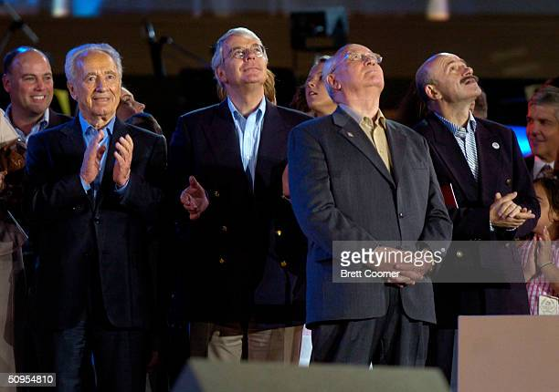Shimon Peres John Major Mikhail Gorbechev and Carlos Salinas watch the sky as the US Army's Golden Knights parachute into Minute Maid Park during...