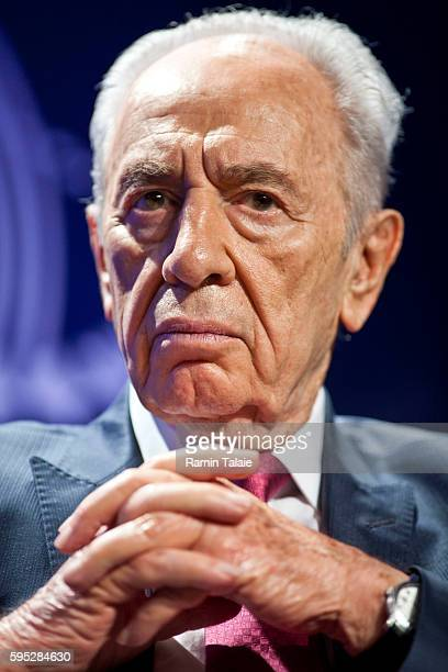 Shimon Peres, President of Israel, listens to speakers during the annual Clinton Global Initiative meeting in New York, on Tuesday, September 21,...