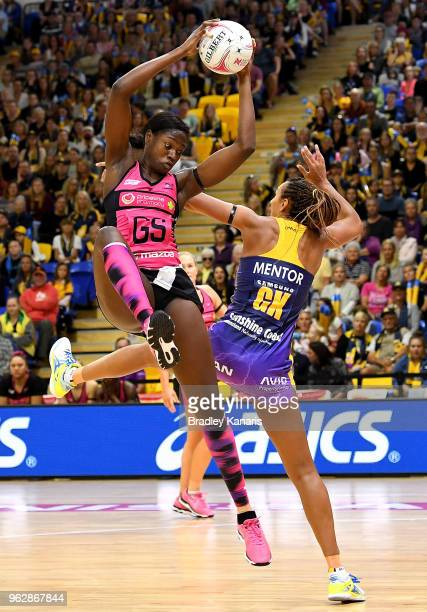 Shimona Nelson of the Thunderbirds and Geva Mentor of the Lightning challenge for the ball during the round five Super Netball match between the...