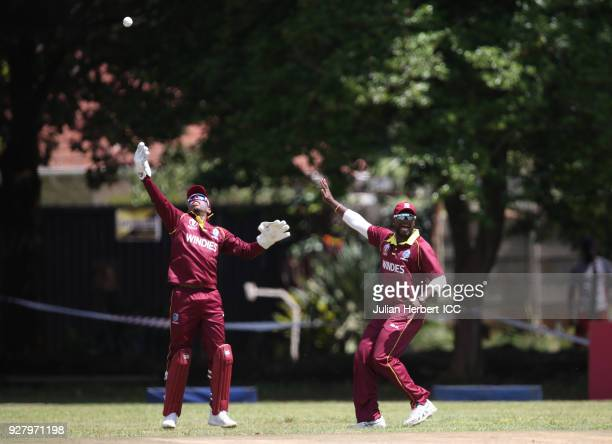 Shimron Hetmyer and Ashley Nurse of The West Indies celebrate the wicket of Rohan Mustafa of The UAE during The ICC Cricket World Cup Qualifier...