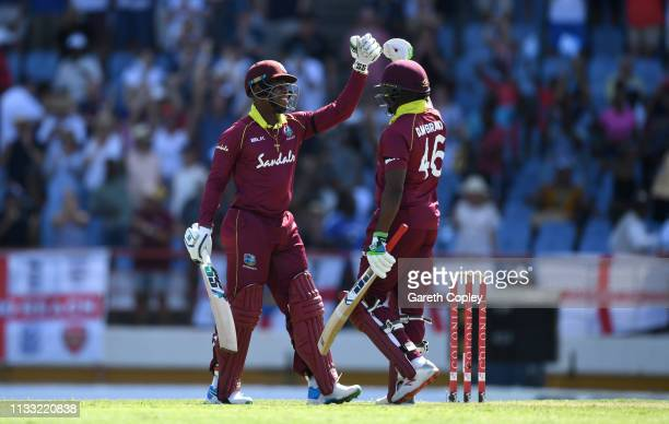 Shimron Hetmyer and Darren Bravo of the West Indies celebrate winning the Fifth One Day International match between England and West Indies at Darren...