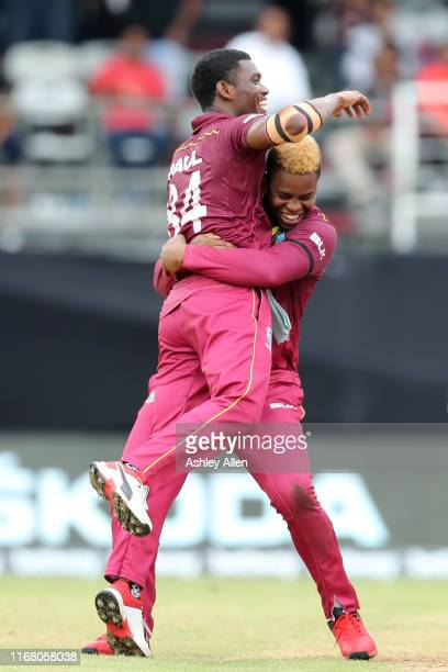 Shimron Hetmyer and Keemo Paul of the West Indies celebrate a wicket during the third MyTeam11 ODI between the West Indies and India at the Queen's...
