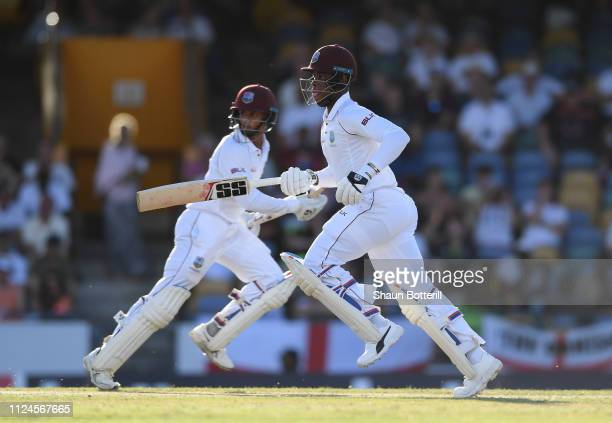 Shimron Hetmyer and Shane Dowrich of West Indies run between the wickets during Day Two of the First Test match between England and West Indies at...