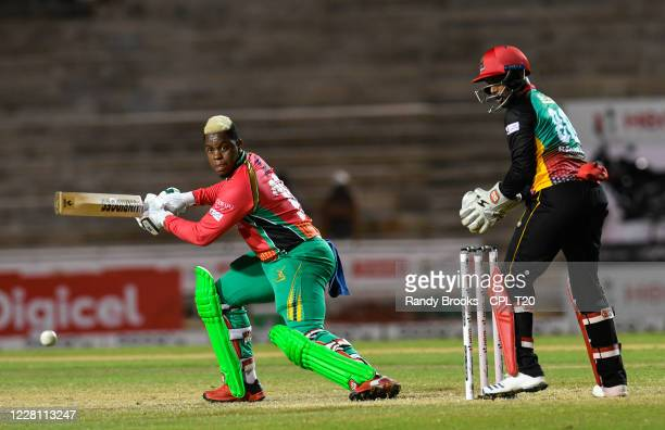 Shimron Hetmyer of Guyana Amazon Warriors hits 4 as Denesh Ramdin St Kitts & Nevis Patriots watch during the Hero Caribbean Premier League match 4...