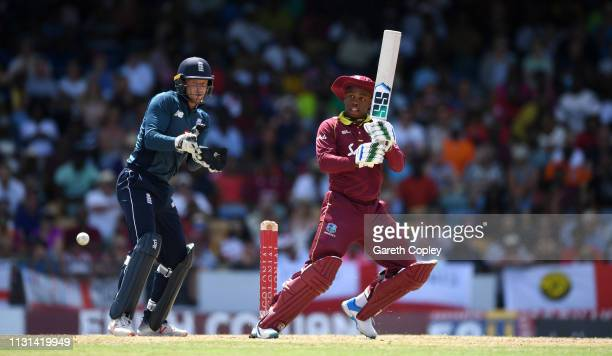 Shimron Hetmyer of the West Indies bats watched by England wicketkeeper Jos Buttler during the 2nd One Day International match between the West...