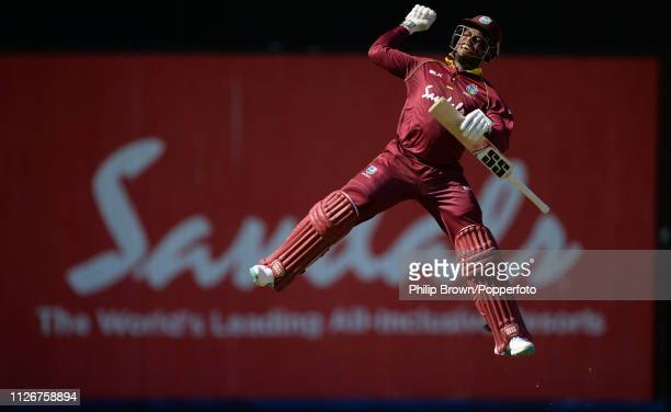 Shimron Hetmyer of the West Indies celebrates reaching his century during the second one-day international between the West Indies and England at...