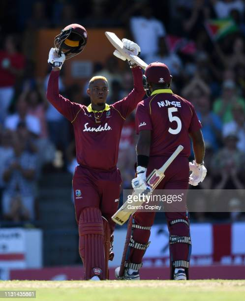 Shimron Hetmyer of the West Indies celebrates with Ashley Nurse after reaching his century during the 2nd One Day International match between the...
