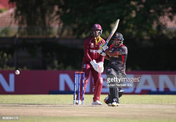 Shimron Hetmyer of The West Indies looks on as Adnan Mufti of The UAE hits out during The ICC Cricket World Cup Qualifier between The West Indies and...