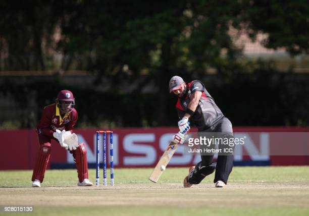 Shimron Hetmyer of The West Indies looks on as Rameez Shahzad of The UAE hits out during The ICC Cricket World Cup Qualifier between The West Indies...