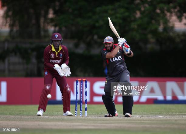 Shimron Hetmyer of The West Indies looks on as Rameez Shahzad of The UAE hitsout during The ICC Cricket World Cup Qualifier between The West Indies...