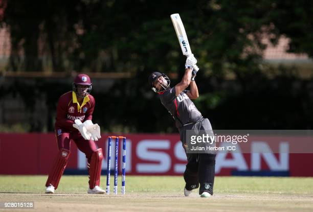 Shimron Hetmyer of The West Indies looks on as Shaiman Anwar of The UAE hits out during The ICC Cricket World Cup Qualifier between The West Indies...