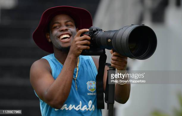 Shimron Hetmyer of the West Indies smiles after borrowing a camera and lens during a training session before the first one-day international against...