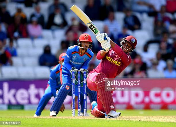 Shimron Hetmyer of West Indies in action batting as Ikram Ali Khil of Afghanistan looks on during the Group Stage match of the ICC Cricket World Cup...