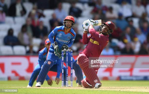 Shimron Hetmyer of West Indies plays a shot as Ikram Ali Khil of Afghanistan looks on during the Group Stage match of the ICC Cricket World Cup 2019...