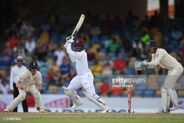 Shimron Hetmyer of West Indies plays a shot as Keaton Jennings and Ben Foakes of England look on during Day Two of the First Test match between...