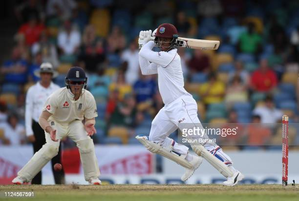 Shimron Hetmyer of West Indies plays a shot as Keaton Jennings of England looks on during Day Two of the First Test match between England and West...