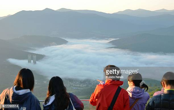 Shimukappu Japan Visitors view a sea of clouds over the village of Shimukappu in Hokkaido northern Japan on the early morning of July 14 2013