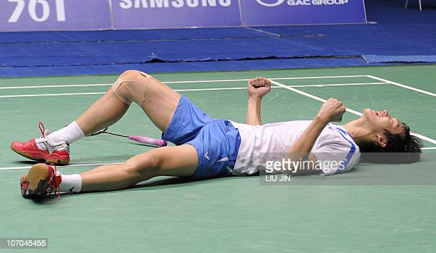 Shin BaekCheol of South Korea celebrates with his partner Lee HyoJung after beating Zhang Nan and Zhao Yunlei of China during their mixed doubles...