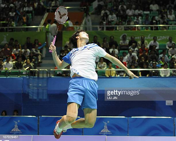 Shin BaekCheol of South Korea leaps to smash a shuttlecock with his partner Lee HyoJung against He Hanbin and Ma Jin of China during their mixed...