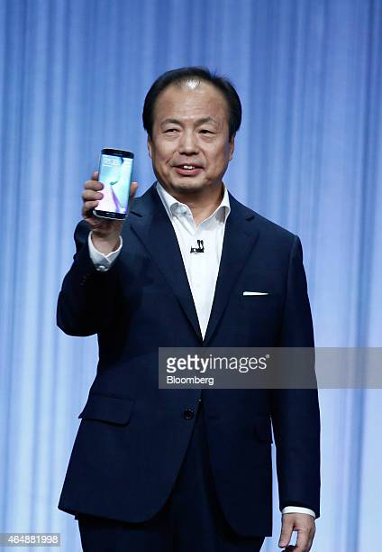 JK Shin chief executive officer of Samsung Electronics Co holds a Galaxy S6 smartphone during a news conference in Barcelona Spain on Sunday March...