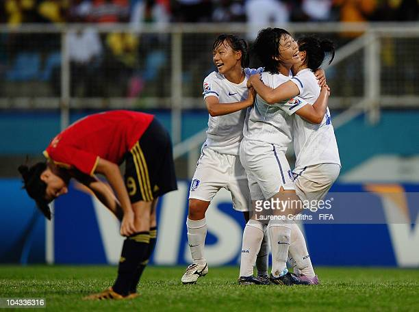 Shin Damyeong of South Korea leads the celebrations on the fianl whistle as Paloma Lazaro of Spain shows her dissapointment during the FIFA U17...