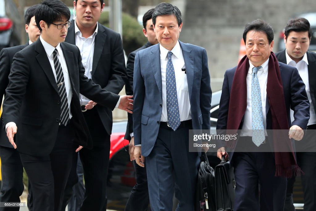 Shin Dong-joo, chief executive officer of Kwang Yoon Sa and former vice chairman of Lotte Group, center, arrives at the Seoul Central District Court in Seoul, South Korea, on Monday, March 20, 2017. The Shin family trial began the proceeding today after indicting Lotte Group founder Shin Kyuk-ho and his three oldest children in October on charges ranging from embezzlement to fiduciary breaches amounting to about 280 billion won ($247 million). Photographer: SeongJoon Cho/Bloomberg via Getty Images