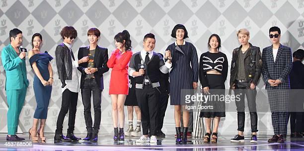 Shin DongYeop Clara Jung JoonYoung Hwang KwangHee of ZEA SunMi Cho SaeHo Hong JinKyung Yoon JinSeo PO and Zico of Block B pose for photographs during...