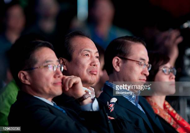 JK Shin head of Samsung Electronics Co's mobilephone division second from left attends the launch event for Samsung's Galaxy Nexus smartphone running...