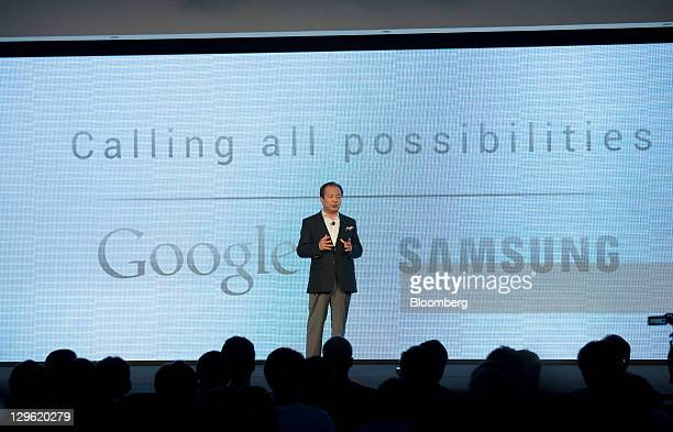 JK Shin head of Samsung Electronics Co's mobilephone division speaks during the launch of the Samsung Galaxy Nexus smartphone running Google Inc's...