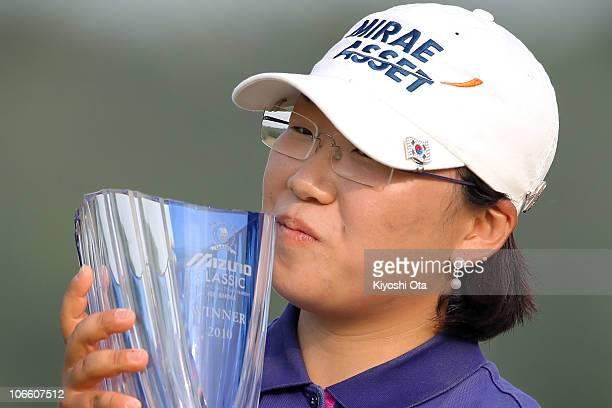 Shin Jiyai of South Korea poses to kiss the trophy during an award ceremony after winning the Mizuno Classic at Kintetsu Kashikojima Country Club on...