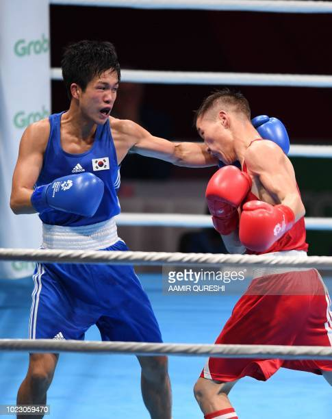 Shin Jonghun of South Korea competes against Enkhmandakh Kharkhuu of Mongolia during their men's light fly 49kg boxing round of 32 match at the 2018...