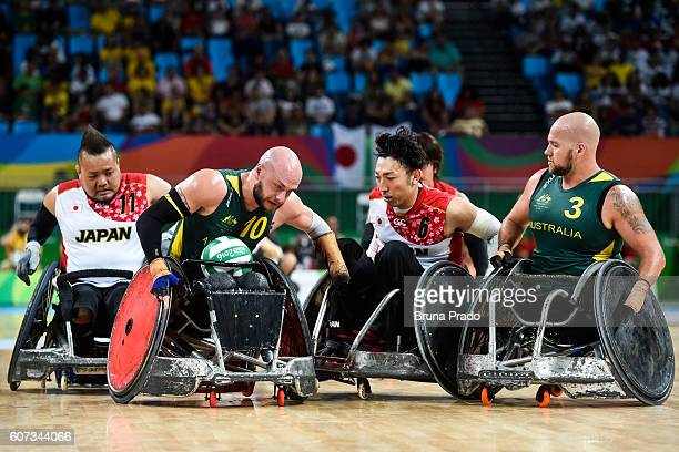 Shin Nakazato Kazuhiko Kanno of Japan Chris Bond and Ryley Batt of Australia compete during the Wheelchair Rugby SemiFinal match between Australia...