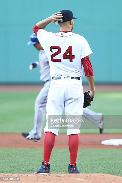 Shin Soo Choo of the Texas Rangers rounds the bases after hitting a home run as David Price of the Boston Red Sox looks on during the game at Fenway...